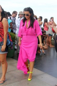 kim-kardashian-kanye-west-rio-de-janeiro-brazil-juan-carlos-obando-frayed-blouse-fall-2012-hot-pink-asymmetric-skirt-christian-louboutin-neon-unbout-illusion-pumps-2